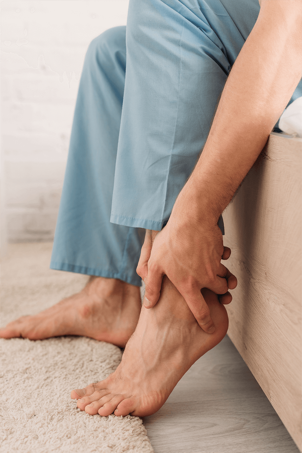 cropped-view-of-man-touching-leg-while-suffering-f-959PR6C.png